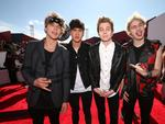 Musicians Ashton Irwin, Calum Hood, Luke Hemmings and Michael Clifford of 5 Seconds of Summer attend the 2014 MTV Video Music. Picture: Getty