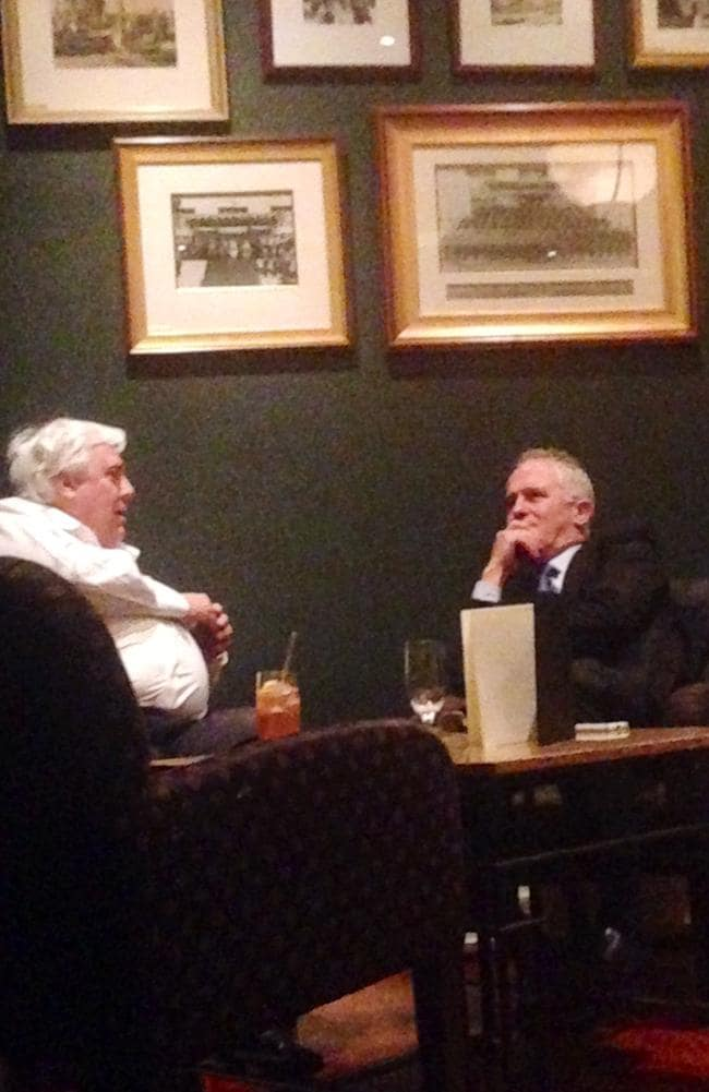 Clive Palmer and Malcolm Turnbull enjoy a drink together at the Hyatt Hotel in Canberra on Tuesday.