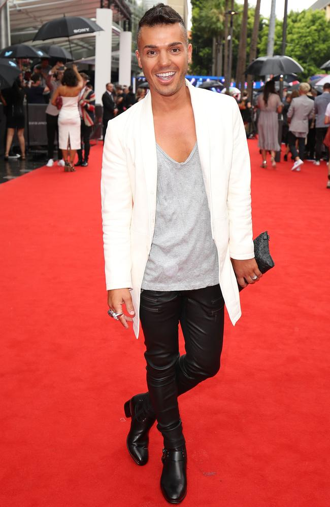 Anthony Callea kicks up his heels on the red carpet.