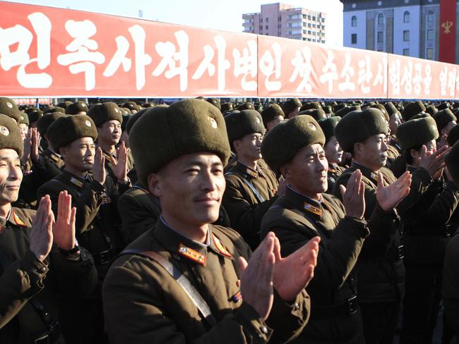 North Korean military personnel clap hands in a rally, after news it had conducted a hydrogen bomb test.