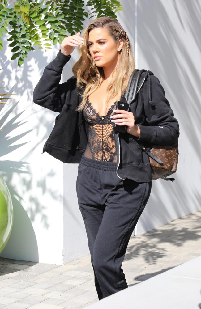 Khloe Kardashian followed Kim's lead and teamed a bodysuit with adidas trackies. Picture: Backgrid