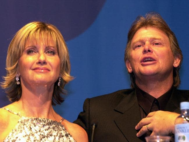 Dare to dream ... Olivia Newton-John with singer John Farnham during Sydney Olympic Games opening ceremony press conference in 2000.
