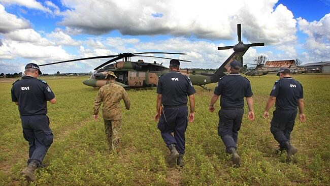 A Disaster Victim Identification teams uses an Australian Defence Force Blackhawk to collect remains of victims killed in the 2011 flash flood in the Queensland town of Grantham. Picture: News Limited.