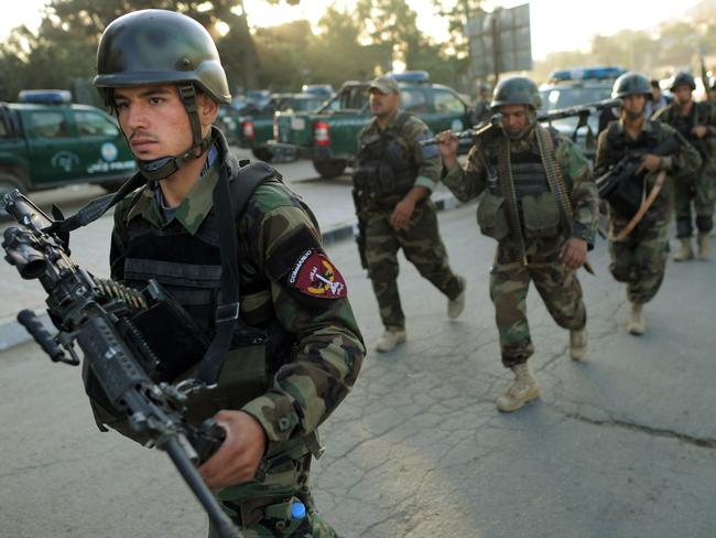 Afghan soldiers walk towards the Intercontinental Hotel in Kabul, Afghanistan, during the 2011 attack. Picture: Supplied
