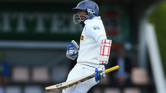 Tillakaratne Dilshan celebrates his ton in on day three.