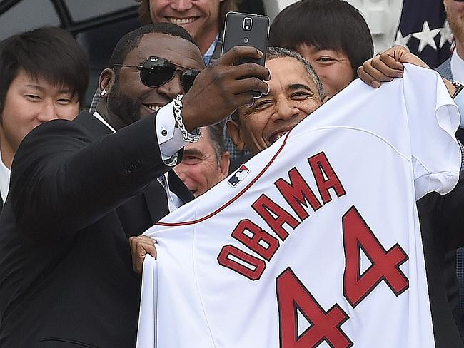Mixing at the White house ... Red Sox Designated Hitter David Ortiz takes a selfie with US President Barack Obama after presenting his a jersey during a ceremony on the South Lawn at the White House in Washington, DC, on April 1, 2014.
