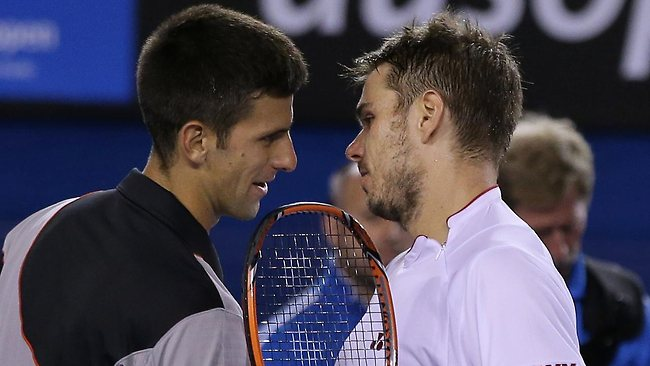 Stanislas Wawrinka of Switzerland, right, is congratulated by Novak Djokovic of Serbia at the net after Wawrinka's win in their quarter-final at the Australian Open.