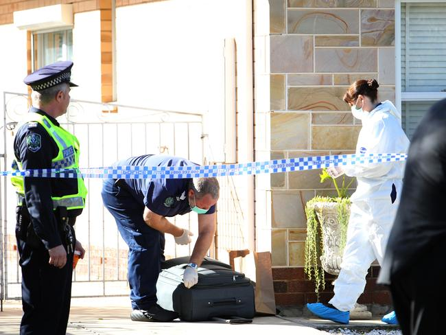 Police attend the scene of a murder at Rawson St, Alberton, in Adelaide, Sunday morning. Picture: Stephen Laffer