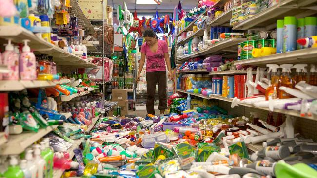 A worker cleans up a party supplies store hit by the earthquake in Napa, California.