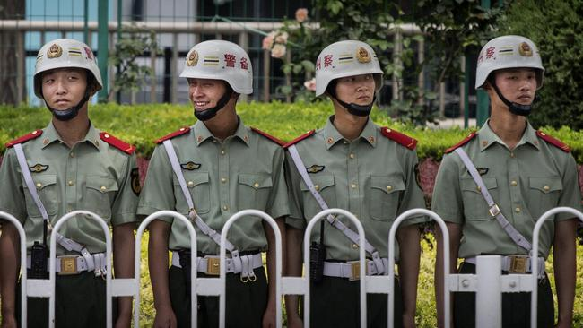 In line ... Chinese Paramilitary police stand guard near Tiananmen Square on June 4, 2014, in Beijing, China. Picture: Kevin Frayer/Getty Images