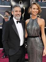 Obviously needing a firm hand when it comes to love George Clooney mended his broken heart with former pro-wrestler Stacy Keibler whom he met at an Oscars party. The pair split mid 2013. Picture: AP