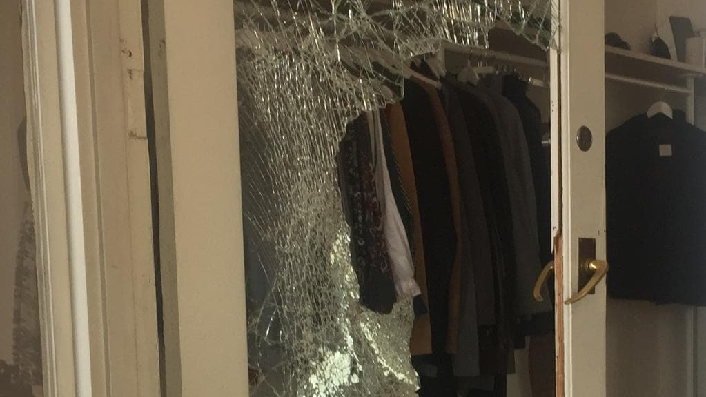 A smashed front door at Bruce designer consignment store in Fitzroy North. Picture: Tamsin Rose