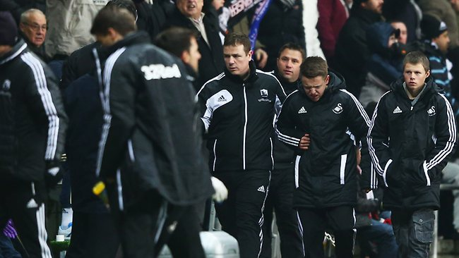 A BALLBOY limps off after being kicked by Eden Hazard of Chelsea at Liberty Stadium . Picture: Michael Steele