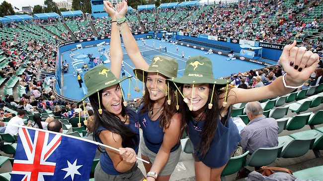 2011 Australian Open. Tennis. Day 2. Colour. Fans. Melbourne girls and Aussie supporters Lauren Massimo, Bianca Fedele and Linda Quijano wearing traditional blue singlets, shorts and thongs .