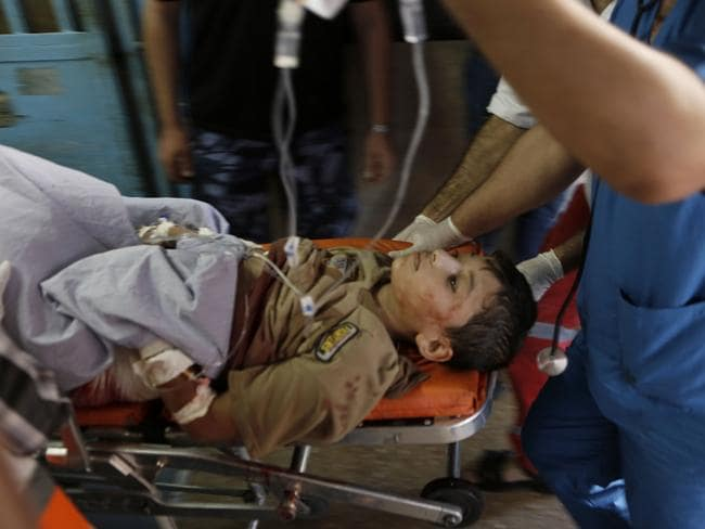 Rushed to hospital ... a Palestinian child who was wounded in an Israeli strike on a compound housing a UN school in Beit Hanoun, in the northern Gaza strip.