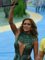 US singer Jennifer Lopez waves to fans after performing during the opening ceremony of the 2014 FIFA football World Cup at the Corinthians Arena in Sao Paulo on June 12, 2014. AFP PHOTO / VANDERLEI ALMEIDA