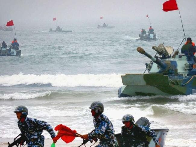 Chinese amphibious tanks and marines storm a beachhead in an assault drill during a Sino-Russian joint military exercise in Shandong province. Photo: Xinhua