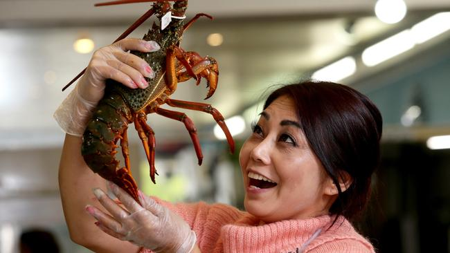 Sally Lam, pictured with some of the seafood available at the Golden Seafood Market in Canley Heights.