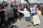 <p>Pro-drug-gang protesters taunt Mexican riot police in the northern industrial city of Monterrey, 17/02/2009 during one of a number of protests in several border cities demanded that the Mexican army leave their cities, with officials saying the protests are organized by drug cartels trying to disrupt the government's anti-drug crackdown.</p>