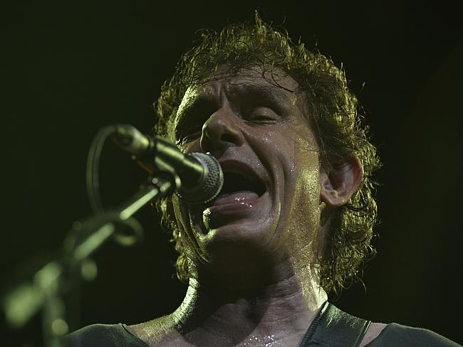 Bit by the family cat ... Ian Moss' injury blamed for Cold Chisel's axing of a Melbourne gig in 2012.
