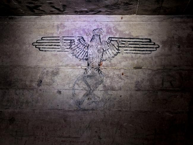 A Nazi eagle stencilled on the wall of one of the bunkers. Picture: Solveig Grothe/Spiegel Online