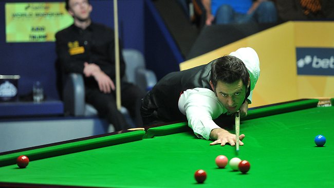 Ronnie O'Sullivan at the table during his semi final win over Judd Trump in the Snooker World Championships at the Crucible in Sheffield. Picture: Anna Gowthorpe