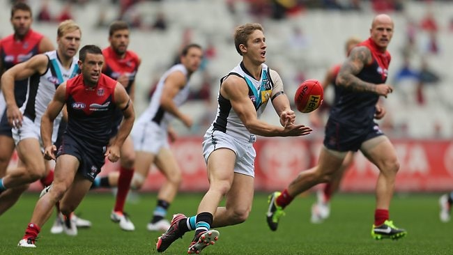 MELBOURNE, AUSTRALIA - MARCH 31: Hamish Hartlett of the Power passes the ball during the round one AFL match between the Melbourne Demons and Port Adelaide Power at the Melbourne Cricket Ground on March 31, 2013 in Melbourne, Australia. (Photo by Scott Barbour/Getty Images)