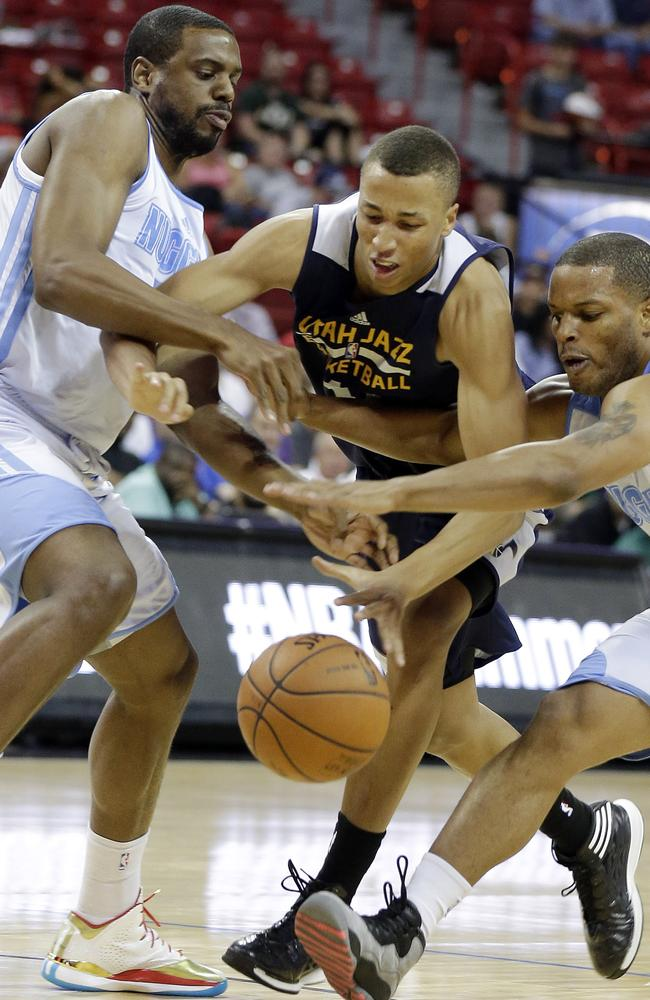 Utah Jazz's Dante Exum, centre, reaches for a loose ball with Denver Nuggets' Will Thomas, left, and Chris Wright during the first half of an NBA Summer League game.