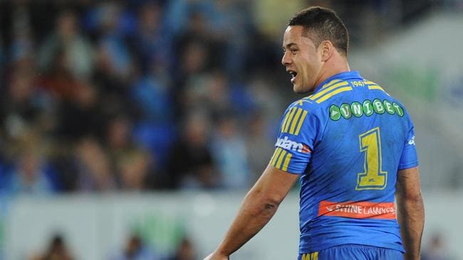 Jarryd Hayne of the Eels reacts towards Nate Myles of the Titans.