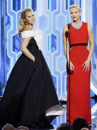 Amy Schumer and Jennifer Lawrence speak onstage during the Golden Globe Awards. Picture: Getty Images