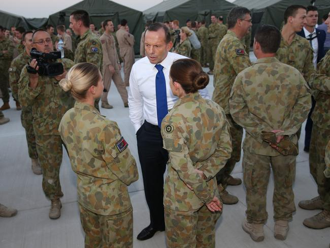 Abbott visited Royal Australian Air Force personnel based in the Middle East along with Air Chief Marshal Mark Binskin, AC, Chief of the Defence Force and the new Minister for Defence Kevin Andrews. Picture: Gary Ramage