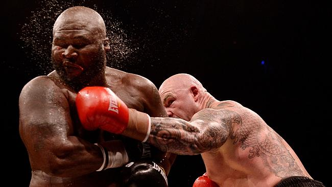 Lucas Browne lays a punch on (L) James Toney during the heavyweight fight.