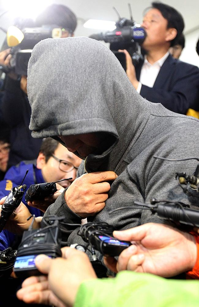 Under investigation ... Lee Joon-Seok, captain of the South Korean ferry that capsized at sea off the coast of Jindo, is interviewed at Mokpo police station in Mokpo. Picture: Yonhap