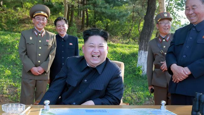 """CORRECTION - This undated picture released by North Korea's official Korean Central News Agency (KCNA) on May 22, 2017 shows North Korean leader Kim Jong-Un (C) inspecting the test-fire of a ground-to-ground medium-to-long range strategic ballistic missile Pukguksong-2. North Korea on May 22 declared its medium-range Pukguksong-2 missile ready for deployment after a weekend test, the latest step in its quest to defy UN sanctions and develop a weapon capable of striking US targets. / AFP PHOTO / KCNA VIA KNS / STR / South Korea OUT / REPUBLIC OF KOREA OUT ---EDITORS NOTE--- RESTRICTED TO EDITORIAL USE - MANDATORY CREDIT """"AFP PHOTO/KCNA VIA KNS"""" - NO MARKETING NO ADVERTISING CAMPAIGNS - DISTRIBUTED AS A SERVICE TO CLIENTS THIS PICTURE WAS MADE AVAILABLE BY A THIRD PARTY. AFP CAN NOT INDEPENDENTLY VERIFY THE AUTHENTICITY, LOCATION, DATE AND CONTENT OF THIS IMAGE. THIS PHOTO IS DISTRIBUTED EXACTLY AS RECEIVED BY AFP. / """"The erroneous mention[s] appearing in the metadata of this photo by STR has been modified in AFP systems in the following manner: [correcting source and restrictions]. Please immediately remove the erroneous mention[s] from all your online services and delete it (them) from your servers. If you have been authorized by AFP to distribute it (them) to third parties, please ensure that the same actions are carried out by them. Failure to promptly comply with these instructions will entail liability on your part for any continued or post notification usage. Therefore we thank you very much for all your attention and prompt action. We are sorry for the inconvenience this notification may cause and remain at your disposal for any further information you may require."""""""