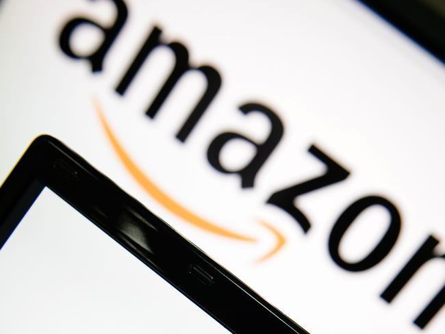 "(FILES) This file photo taken on December 11, 2014 shows the logo of the online retailer Amazon displayed on computer screens in London. EU competition chief Margrethe Vestager on October 4, 2017 ordered Amazon to pay 250 million euros in back taxes linked to an ""illegal tax break"" that Luxembourg granted the internet shopping giant. ""Luxembourg gave illegal tax benefits to Amazon. As a result, almost three quarters of Amazon's profits were not taxed,"" Vestager said in a statement. / AFP PHOTO / LEON NEAL"
