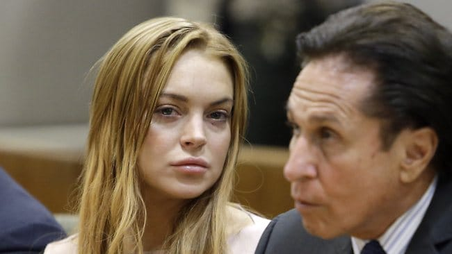 Actress Lindsay Lohan and her attorney Mark Heller in March. Lohan accepted a plea deal in a misdemeanor car crash case that includes 90 days in a rehabilitation facility. Picture: Reed Saxon