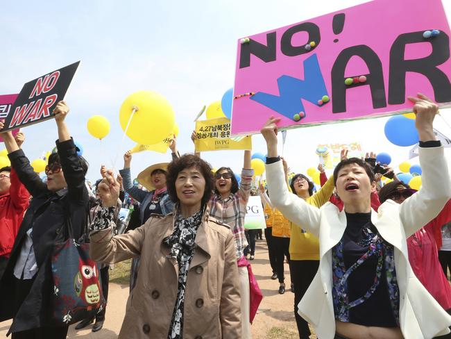 Members of the South Korean women's peace group stage a rally to support the upcoming summit between South and North Korea at the Imjingak Pavilion in Paju, South Korea, near the border with North Korea. Picture: AP