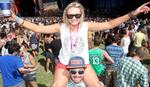Adelaide Big Day Out music festival at Wayville Showgrounds - (l-r) music fans Mieke Hyland on Adam Lyons.