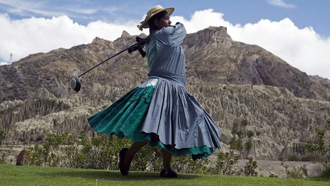 On a golfing high ... Marta Mamani, an aymara indigenous woman, hits a drive during her work break at La Paz Golf Club, consi...