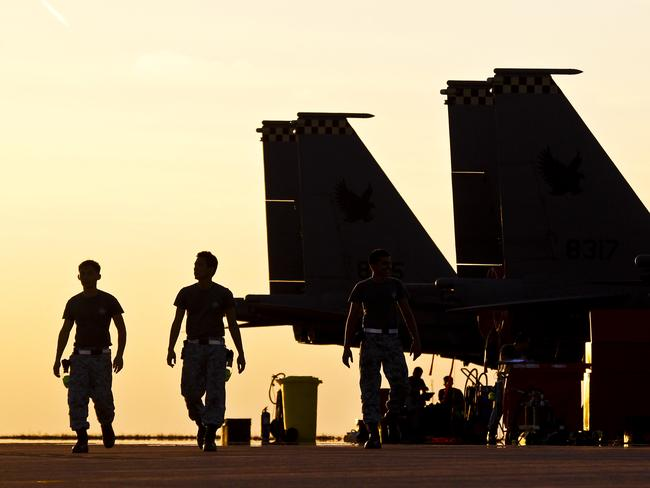 Yellow alert ... Republic of Singapore Air Force personnel work on RAAF Base Darwin's flight line during Exercise Pitch Black 2014. Source: Defence