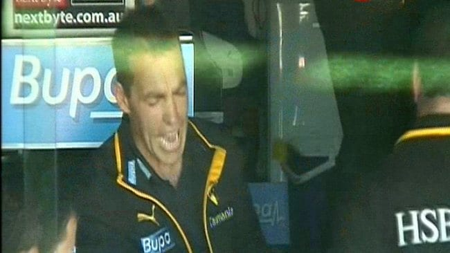 Hawthorn coach Alastair Clarkson just before he takes out his anger on the MCG coaches' box wall.