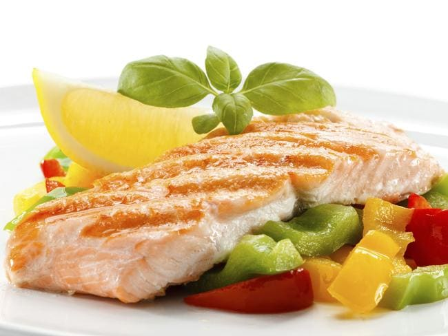 Grilled salmon and vegetables are a great light dinner option.