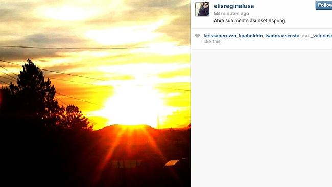 #SPRING: A blazing sun sets behind power lines. Classic Instagram.