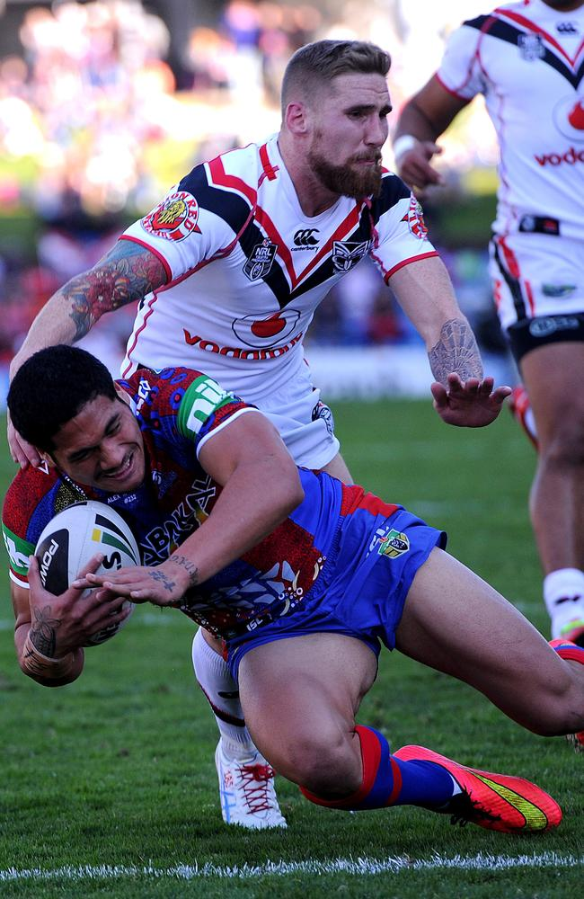 Sione Mata' Utia scores one of his three tries in a breakout performance. Pic: Peter Lorimer.