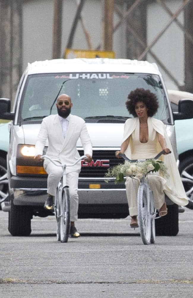 Solange Knowles and Alan Ferguson arrive at their wedding on white bicycles. Picture: Splash