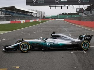 The new 2017 season Mercedes W08 EQ Power+ Formula One car at its launch event at Silverstone motor racing circuit near Towcester, central England on February 23, 2017. / AFP PHOTO / OLI SCARFF