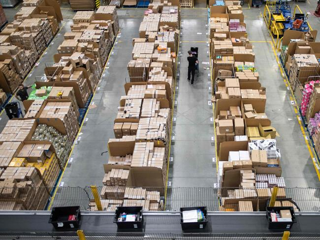 Australian Amazon staff are likely to be working under better conditions than those in other countries, and that might mean Amazon will have to charge more for their delivery. Picture: Chris J Ratcliffe / AFP