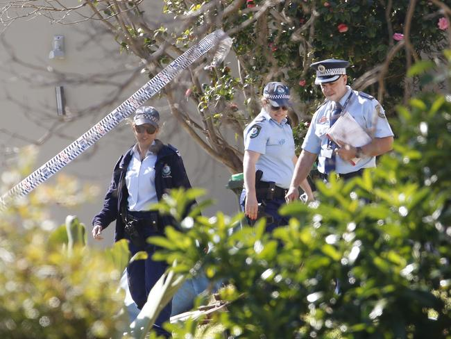 Police officers leave the crime scene on Marine Parade on Monday after Ms Latta could not be saved. Picture: Daniel Munoz.