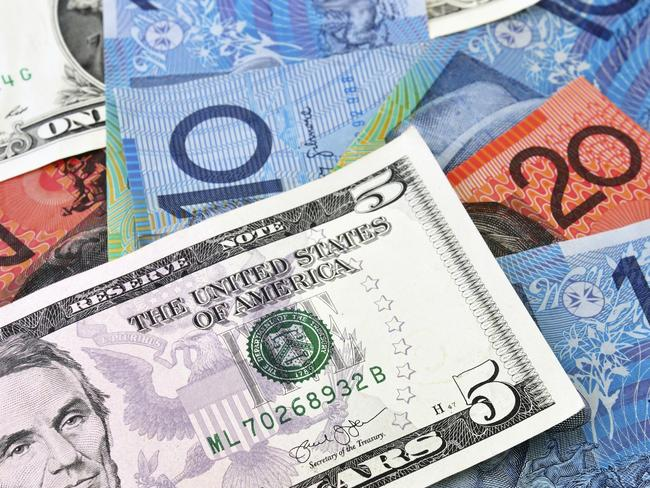 A Combination of US and Australian Dollars banknotes. investing, generic, Australian money