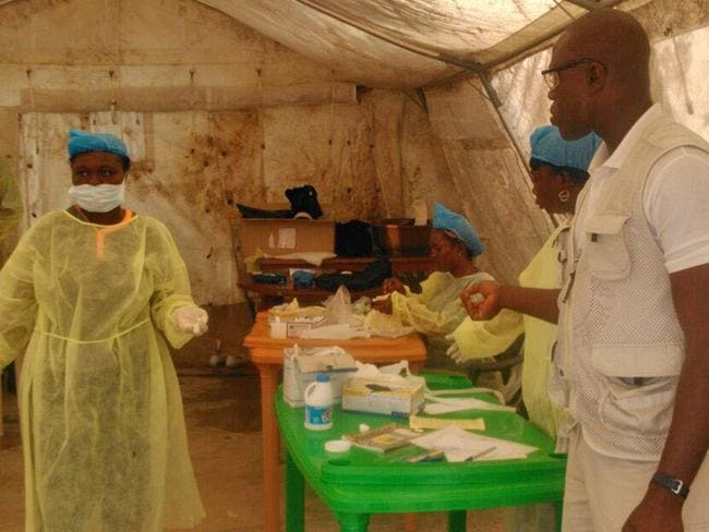 Great risk ... Doctors Without Borders personnel work in the facility in Kailahun, Sierra Leone where Dr. Sheik Humarr Khan died on July 29 after risking his life to treat Ebola patients. Picture: AP